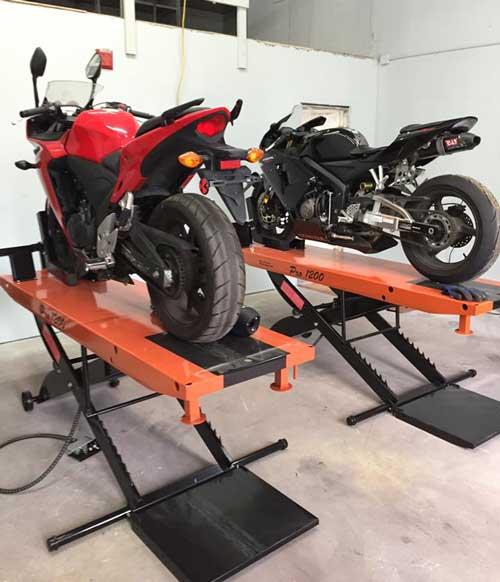 2005 Honda CBR600rr and 2013 Honda CBR500r sit atop PRO 1200 Motorcycle Lift